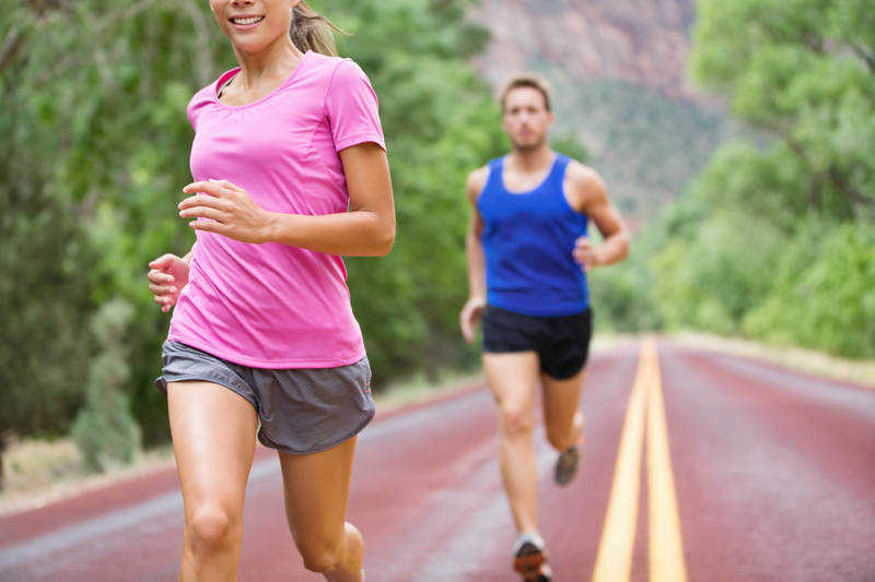 http://www.dreamstime.com/stock-images-marathon-running-athletes-couple-training-road-image38214974