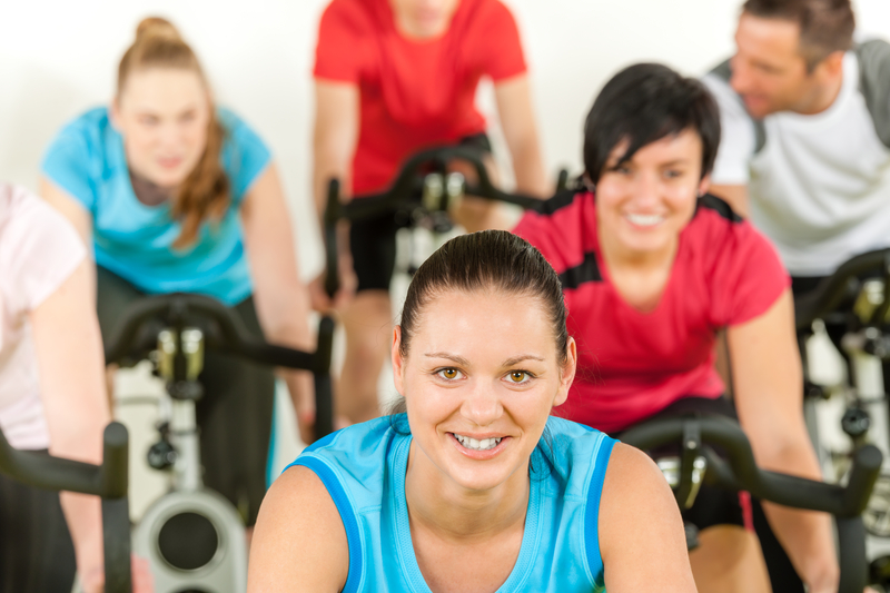 http://www.dreamstime.com/royalty-free-stock-photo-smiling-woman-spinning-class-fitness-workout-image24782855